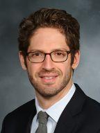 Headshot of Eric Brumberger
