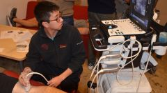 Medical students practice ultrasound techniques on residents